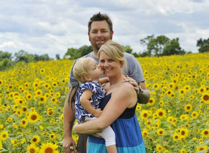 family shot in the sunflowers