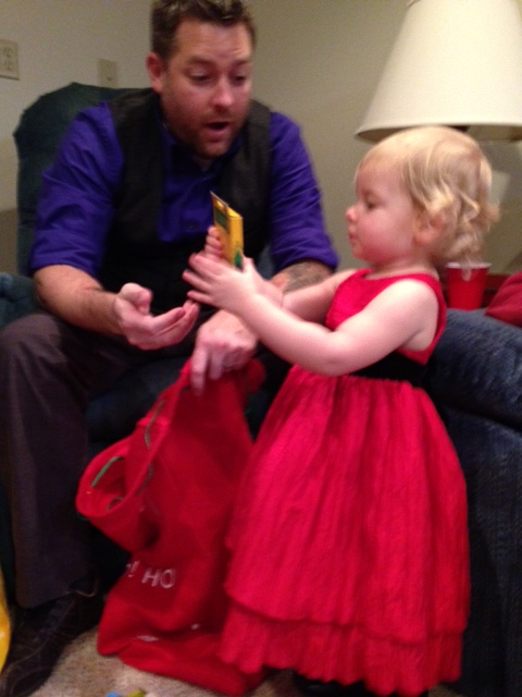 Abbey checking out her bag that Santa left for her on Christmas Eve