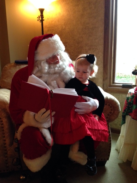 Abbey's turn to sit on Santa's lap