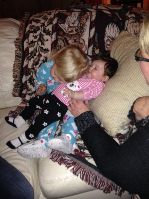 Snuggling with her littlest cousin, Isabella.